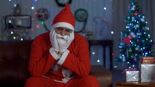 Sad and depressed Santa Claus in glass spectacles waiting for Christmas celebrations in India