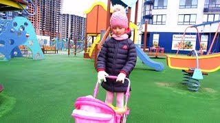 Having Fun with Baby Dolls & Colored Dresses on the Playground