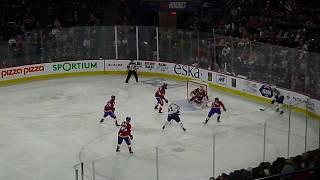 Charlie Lindgren of Laval Rocket makes a glove save vs. Cameron Schilling of Manitoba Moose 2/23/19
