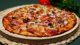 Вкусная домашняя пицца на молоке с колбасой, сыром и помидорами