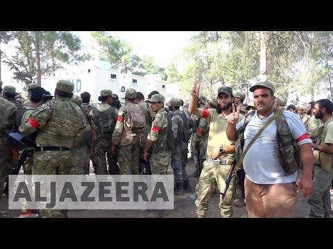 Syrian rebels and Turkish tanks 'seize' ISIL-held town