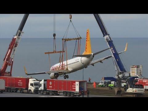 Cranes Lift Passenger Jet From Turkish Hillside