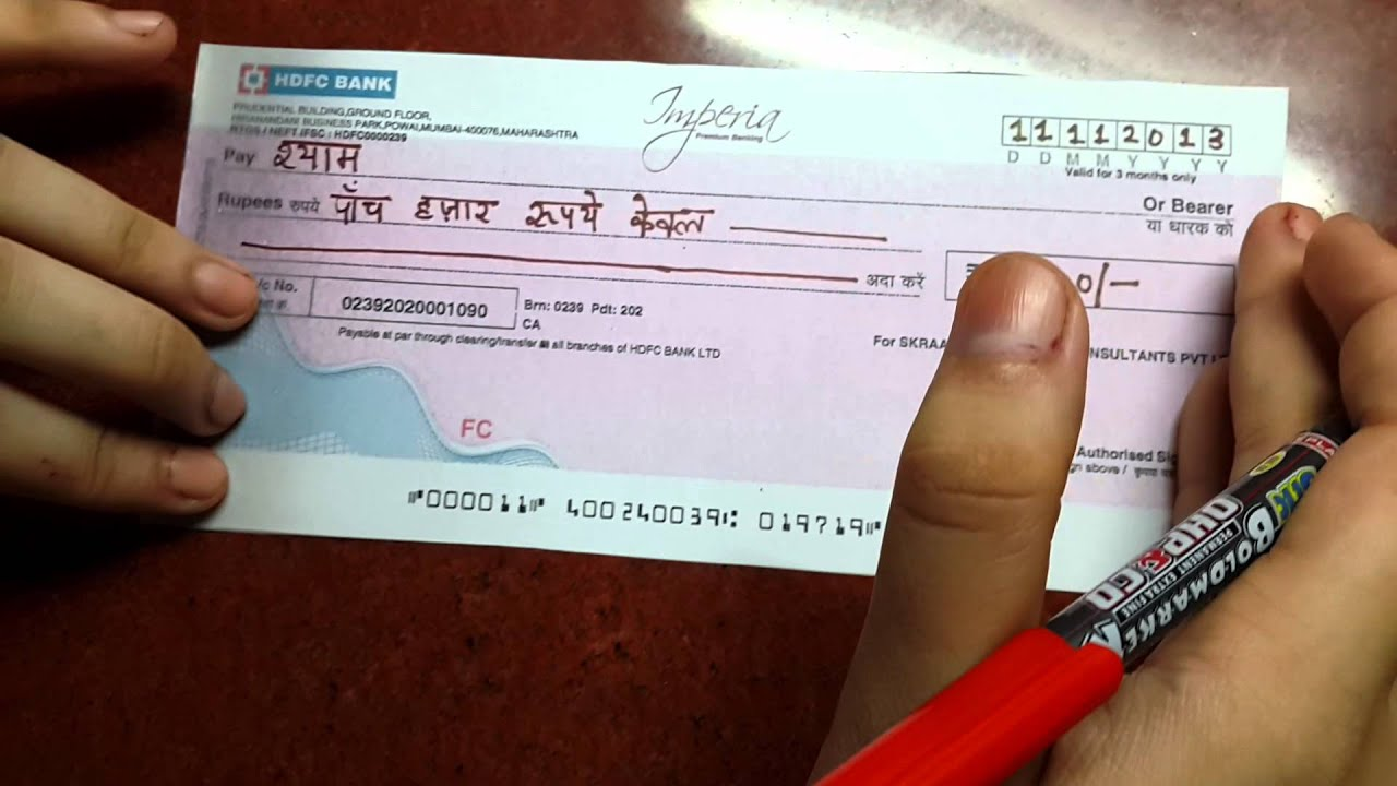 How to fill a cheque - YouTube