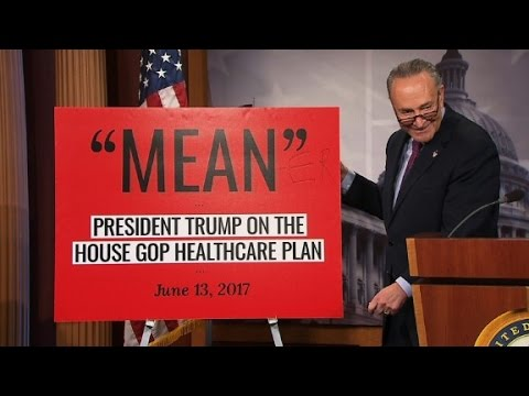 Schumer slams bill with giant 'mean-er' sign