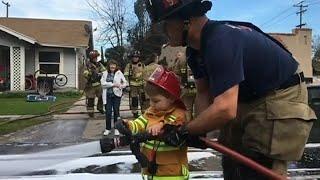 2-year-old boy puts on firefighter costume, helps firemen fight blaze