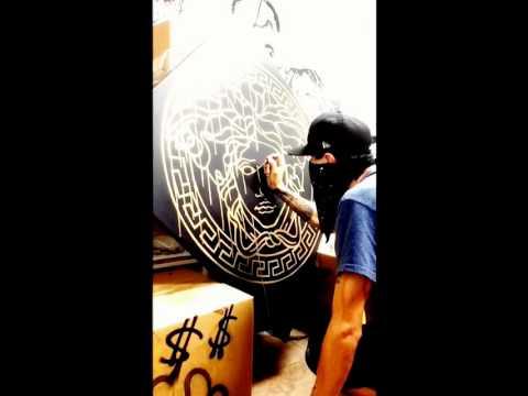 Artist C/Greed in the studio Versace.