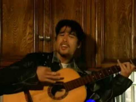 Johnny Tri Nguyen with Guitar