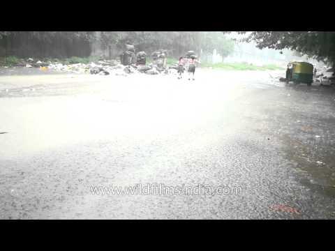 Small kids enjoy the monsoon rain in New Delhi