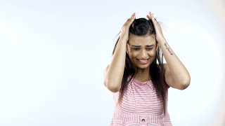 Indian woman suffering from a very strong headache - Sick. Medical issues. Troubled expression