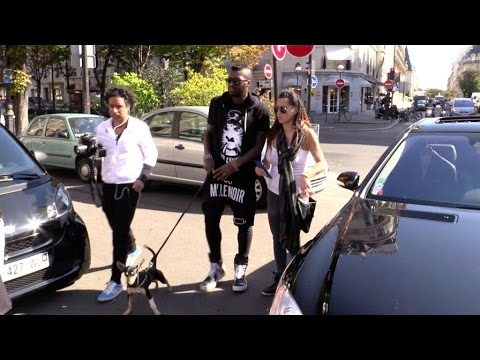 EXCLUSIVE - Djibril Cisse, His pregnant wife and his gog arrive at L'Avenue in Paris