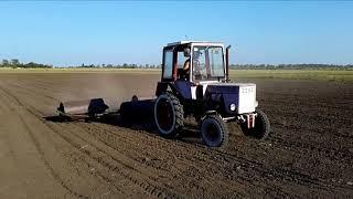 Трактор Т-25 и каток гладко-водоналивной