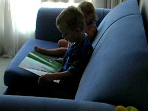 Brodie reading to Jaime Jack and Annie