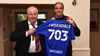Michael Duff presents the new 703 away shirt to Rob Thorndale