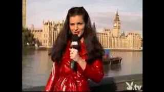 Reporter in shiny red pvc mac