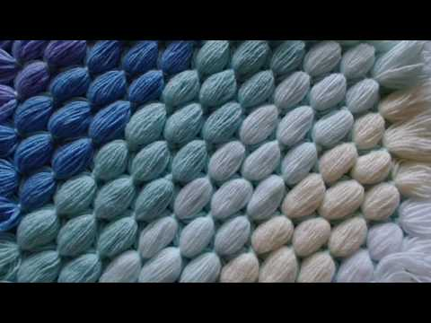 Pom pom blanket.  Diagonal blanket from your scrap balls of wool