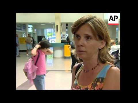 3 French evacuees leave, packed airport terminal