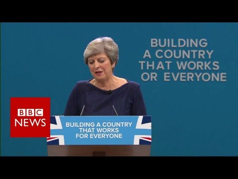 The moment a letter falls off the slogan behind Theresa May - BBC News