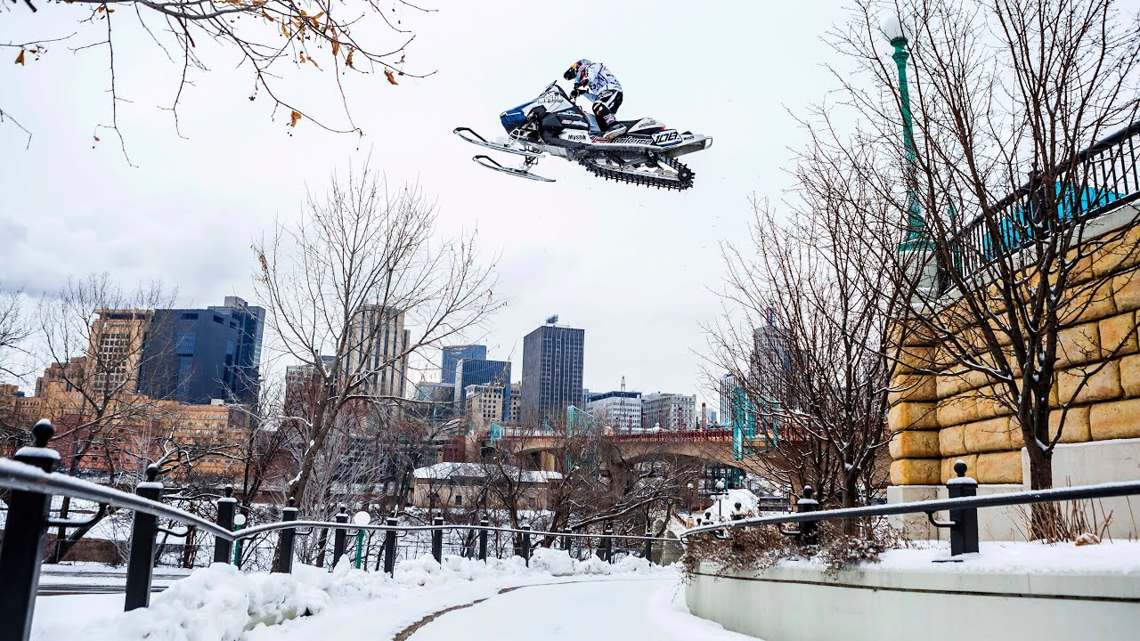 Watch this incredible footage of snowmobiling around US city