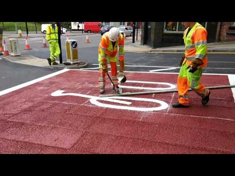 Painting a bicycle on the road