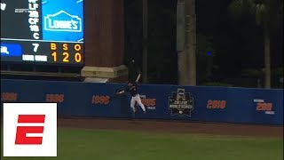 Florida reaches College World Series as 11th-inning fly ball goes off fielder's glove for HR | ESPN