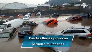 Depósito de autos de lujo se inunda tras lluvias en Edomex