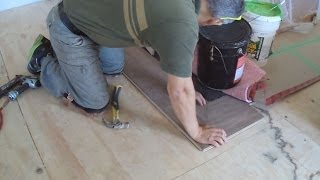 Engineered Hardwood Flooring Installation Around A Marble Tile