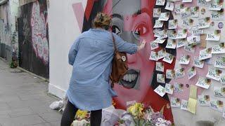 Crowds gather at Savita mural in Dublin