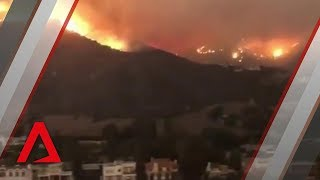 California wildfires spread to Malibu properties