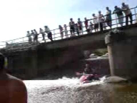 Yalding kayaking sliding down a sluise