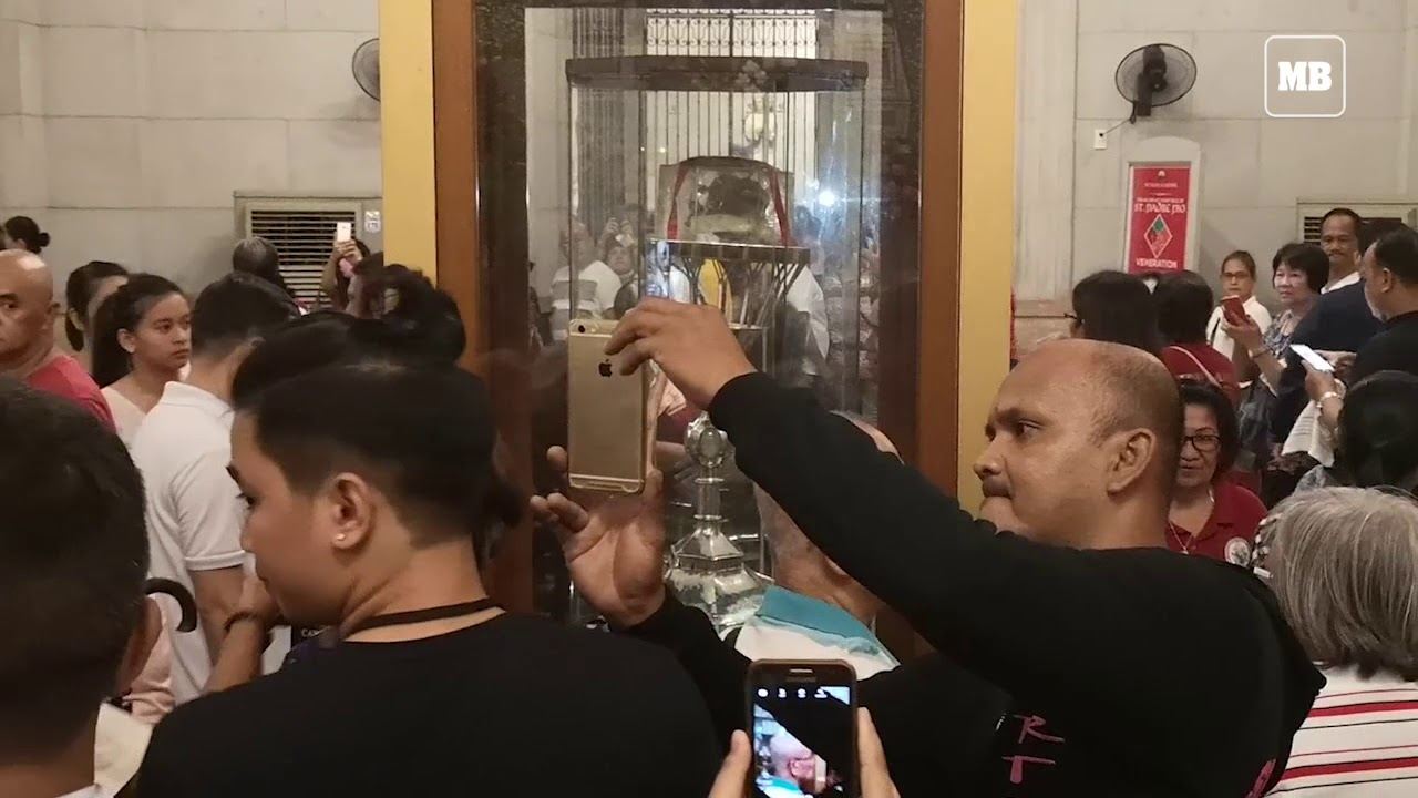 Devotees venerate the 'incorrupt' heart relic of St. Padre Pio at Manila Cathedral.