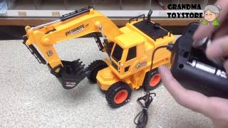 Unboxing TOYS Review/Demo - Remote Control heavy machine Construction site Crane digs thru dirt