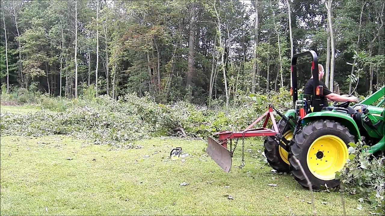 Deere 3032E with AV20H Grapple Cleaning Up Cottonwood