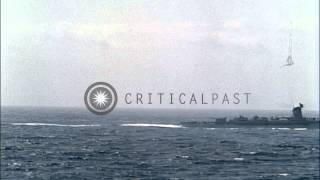 Column of American destroyers passes USS North Hampton during Atlantic Fleet Revi...HD Stock Footage