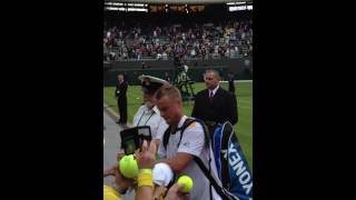 Lleyton Hewitt signs autographs after beating Wawrinka in Round1 at Wimbledon 2013