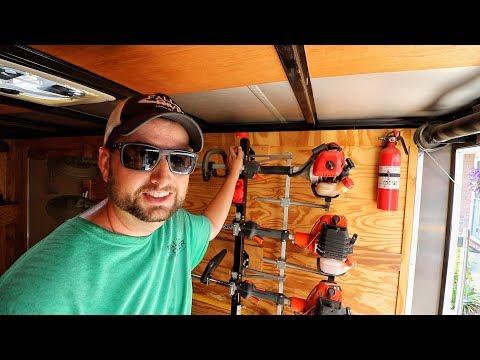 Equipment Defender Trimmer Rack In An Enclosed Trailer