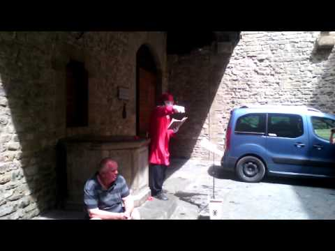 Actor reading the works of Dante Alighieri near his house in Florence