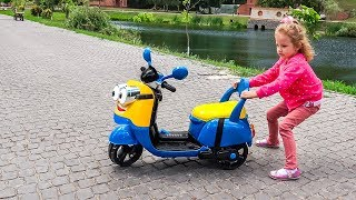 Funny Stories baby Milusik Lanusik by motorcycle on the Playground for children