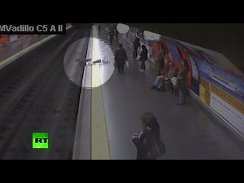 CCTV: Police Pull Woman From Tracks In Madrid Metro