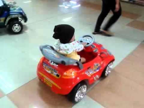 Denis 1 Year Old Enjoy Riding A Red Car