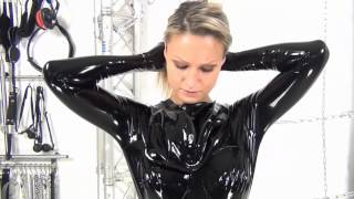 Repeat youtube video Girl puts on a latex / rubber condom catsuit