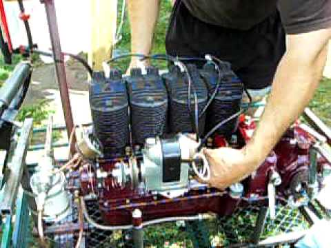 antique 4 cylinder henderson motorcycle engine running on test stand at the AMCA meet in wauseon, oh