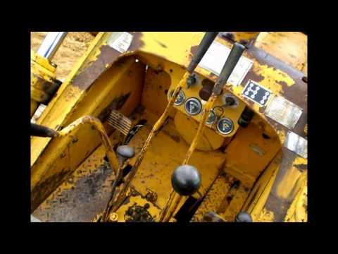 Caterpillar 933 traxcavator slideshow - YouTube