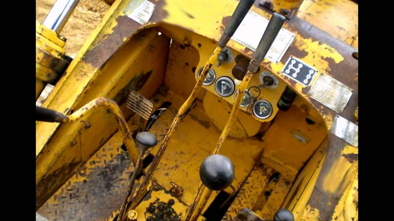 Caterpillar 933 traxcavator slideshow