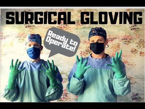 Surgical Gloving - Two Doctors Ready To Operate
