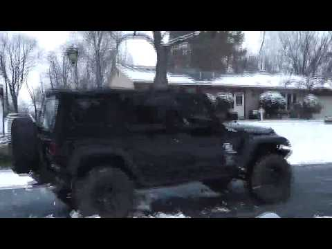 Jeep Crashes into and Runs Over and a Snowman!