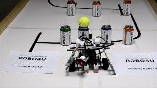 Робот Lego EV3 на трассе с углом, черной линией, кеглями и теннисным мячиком