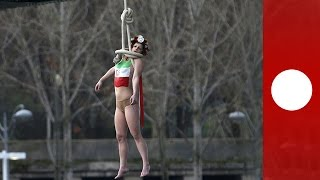 Topless Femen activist stages mock hanging protesting Rouhani visit