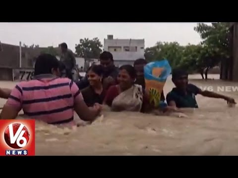 Heavy Rains Lashes Andhra Pradesh   2 Persons Missing In Flood Water   V6 News