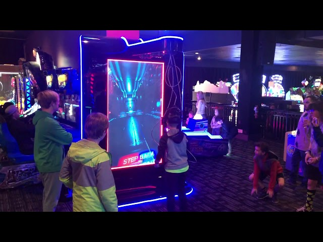 Beat Saber Arcade Cabinet with Big Crowd