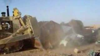 Armored D9 Dozer crushing cars in Iraq